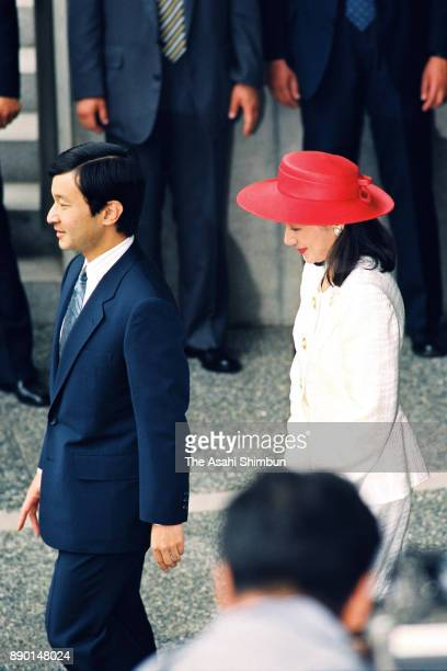 Crown Prince Naruhito and Crown Princess Masako leave after attending the wedding celebration ceremony hosted by Tokyo Metropolitan Government at the...