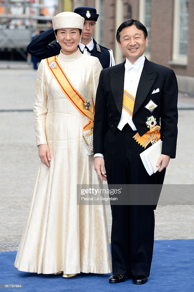 Crown Prince Naruhito and Crown Princess Masako of Japan depart the Nieuwe Kerk to return to the Royal Palace after the abdication of Queen Beatrix of the Netherlands and the Inauguration of King Willem Alexander of the Netherlands on April 30, 2013 in Amsterdam, Netherlands.