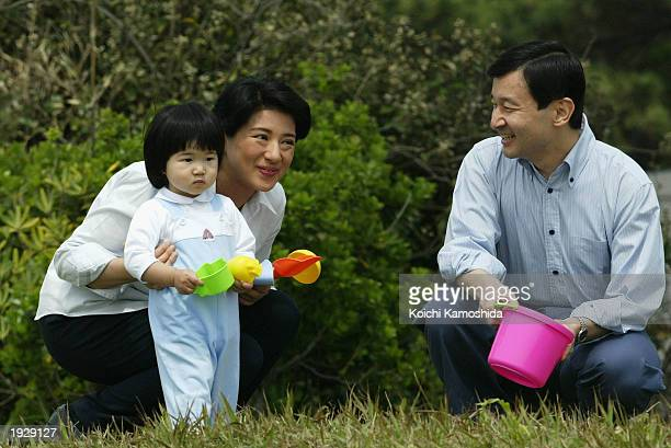 Crown Prince Naruhito and Crown Princess Masako play with their daughter Princess Aiko as they visit the coast near their private house April 13 2003...