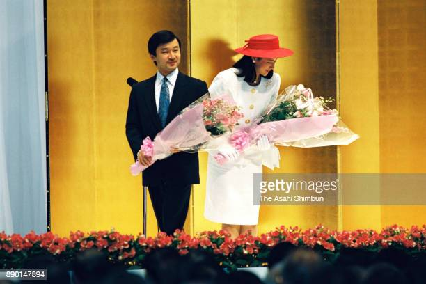 Crown Prince Naruhito and Crown Princess Masako receive flower bunches during the wedding celebration ceremony hosted by Tokyo Metropolitan...