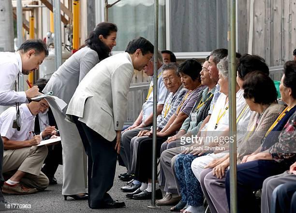 Crown Prince Naruhito and Crown Princess Masako speak to evacuees at a temporary housing on September 22 2013 in Koriyama Fukushima Japan The royal...
