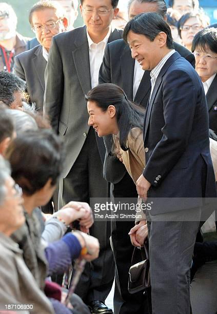 Crown Prince Naruhito and Crown Princess Masako speak to evacuees at a temporary housing on November 2 2013 in Kamaishi Iwate Japan