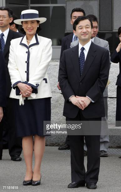 Crown Prince Naruhito and Crown Princess Masako stand as they watch Emperor Akihito and Empress Michiko leave Tokyo International Airport on June 8...