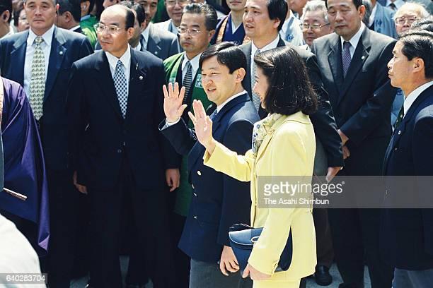 Crown Prince Naruhito and Crown Princess Masako stroll the Nakamise street of Asakusa on April 22 1999 in Tokyo Japan