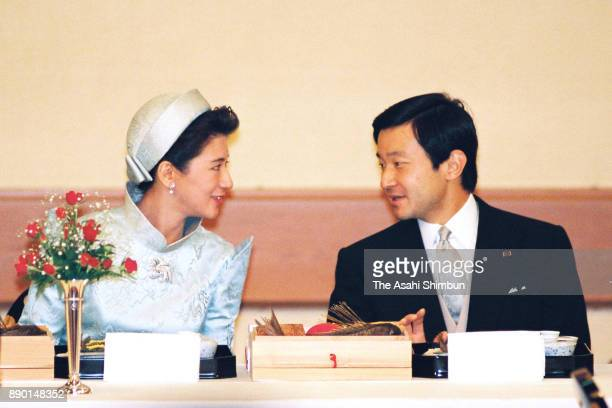 Crown Prince Naruhito and Crown Princess Masako talk during the 'Kyuchu KyoennoGi' wedding dinner at the Imperial Palace on June 16 1993 in Tokyo...