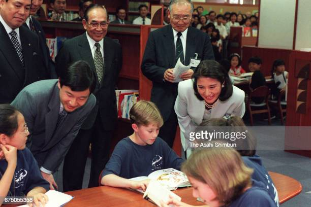 Crown Prince Naruhito and Crown Princess Masako talk to children at Fukuoka City Public Library on May 10 1997 in Fukuoka Japan