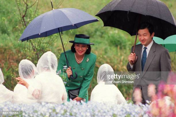 Crown Prince Naruhito and Crown Princess Masako talk to children during the Greenery Promotion Meeting on April 23 1994 in Asuka Nara Japan