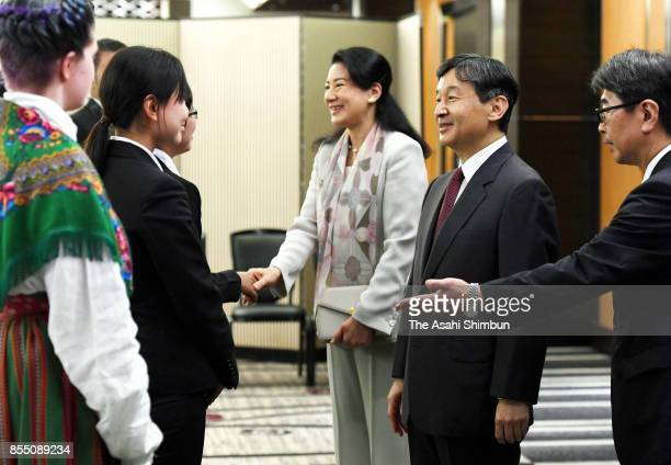 Crown Prince Naruhito and Crown Princess Masako talk to participants at the International Youth Conference on September 27 2017 in Tokyo Japan