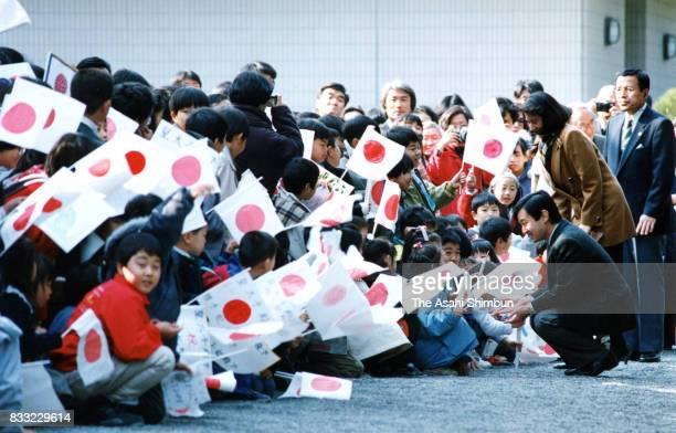 Crown Prince Naruhito and Crown Princess Masako talk with children at the Hayama Shiosai Park on March 5 1994 in Hayama Kanagawa Japan