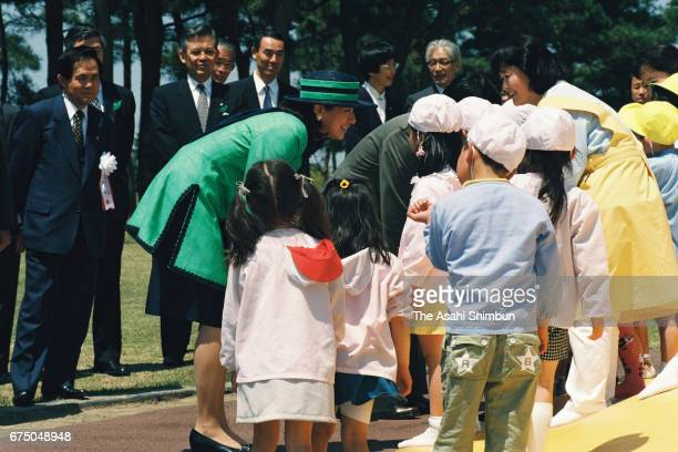 Crown Prince Naruhito and Crown Princess Masako talk with kindergarten children during the greenery conservation meeting at Hitachinaka Kaihin Park...