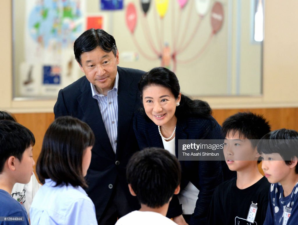 Crown Prince Naruhito and Crown Princess Masako talk with school children at Otoyo Elementary School on July 11, 2017 in Katagami, Akita, Japan.