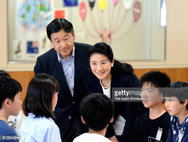 Crown Prince Naruhito and Crown Princess Masako talk with school children at Otoyo Elementary School on July 11 2017 in Katagami Akita Japan