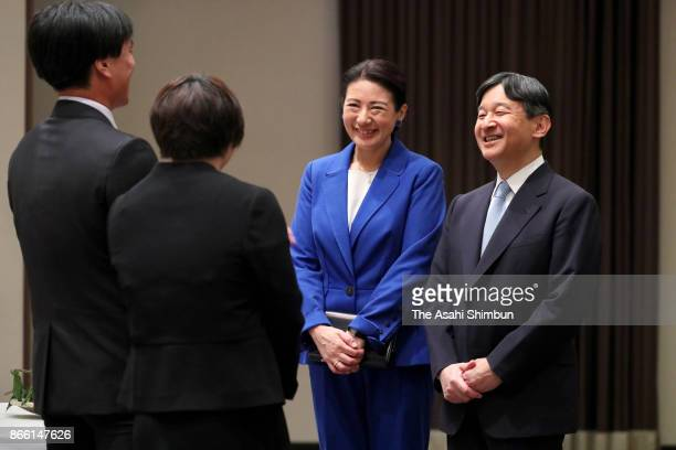 Crown Prince Naruhito and Crown Princess Masako talk with youth farmers during their meeting on October 24 2017 in Kochi Japan