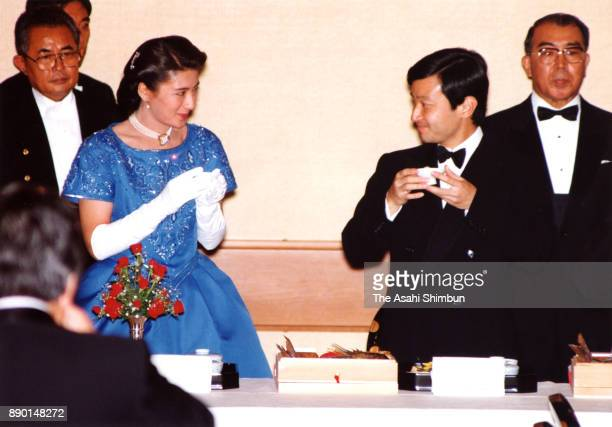 Crown Prince Naruhito and Crown Princess Masako toast during the 'Kyuchu KyoennoGi' wedding dinner at the Imperial Palace on June 15 1993 in Tokyo...