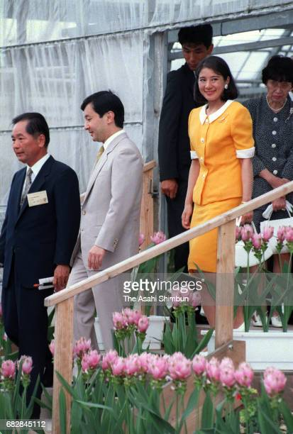 Crown Prince Naruhito and Crown Princess Masako visit a bitter gourd farming facility on July 16 1997 in Okinawa Japan