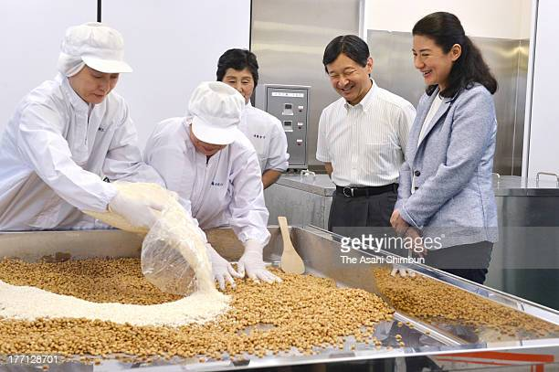 Crown Prince Naruhito and Crown Princess Masako visit a Miso Factory after visiting the evacuees of 2011 Great East Japan earthquake and subsequesnt...
