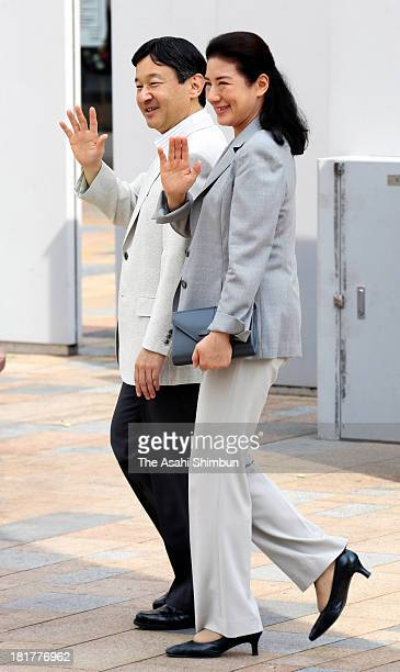 Crown Prince Naruhito and Crown Princess Masako wave to wellwishers upon arrival at JR Koriyama station on September 22 2013 in Koriyama Fukushima...