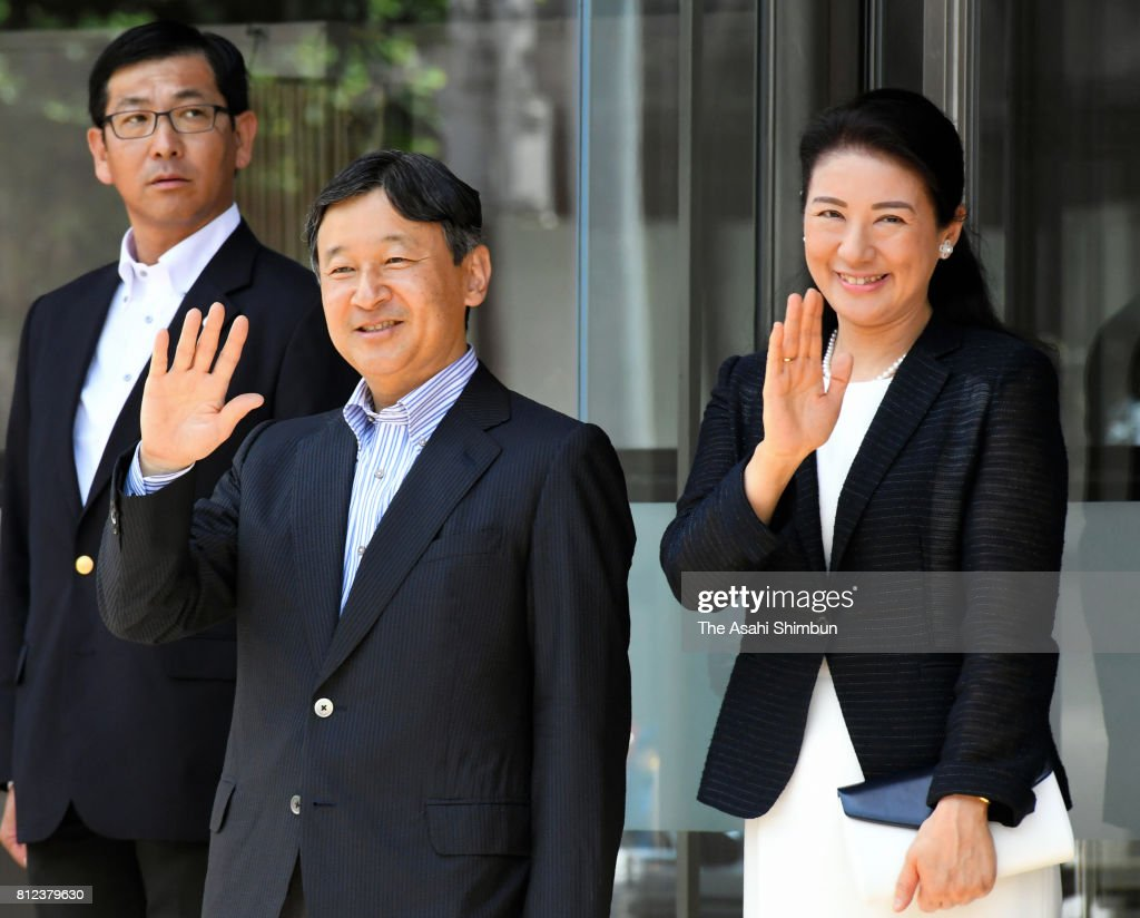 Crown Prince Naruhito and Crown Princess Masako wave to well-wishers on arrival at the Akita Airport on July 10, 2017 in Akita, Japan.
