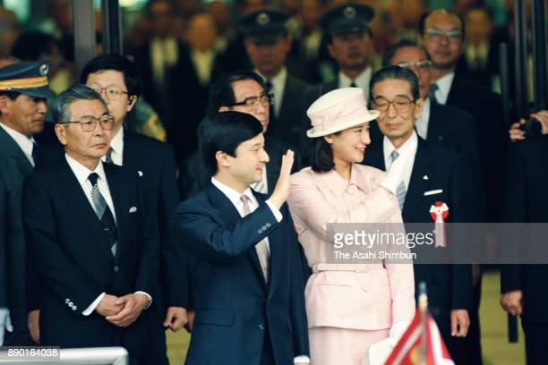Crown Prince Naruhito and Crown Princess Masako wave to wellwishers on arrival at Kintetsu Uji Yamada Station on June 25 1993 in Ise Mie Japan