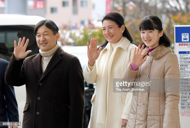 Crown Prince Naruhito Crown Pricness Masako and their daughter Princess Aiko wave to wellwishers on arrival at Nagano Station on March 27 2017 in...