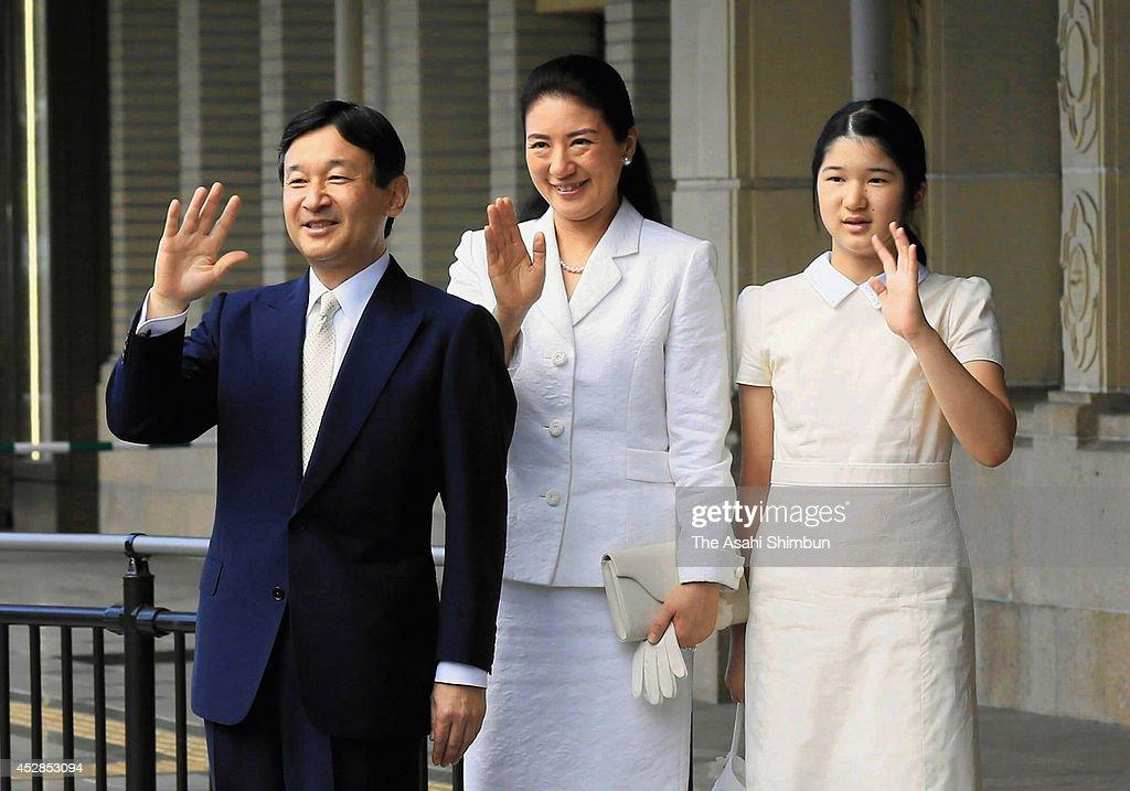 Crown Prince Naruhito Crown Princess Masako and Princess Aiko wave to wellwishers upon arrival at Ujiyamada station on July 28 2014 in Ise Mie Japan...