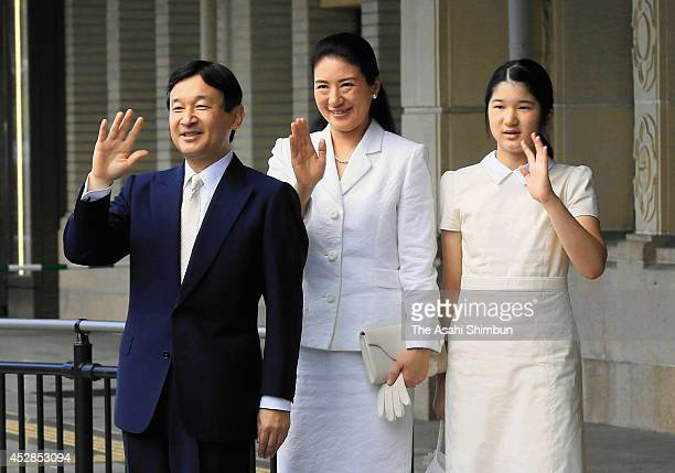 Crown Prince Naruhito Crown Princess Masako and Princess Aiko wave to wellwishers upon arrival at Ujiyamada station on July 28 2014 in Ise Mie Japan...