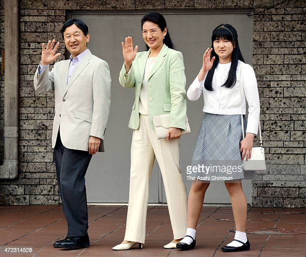 Crown Prince Naruhito Crown Princess Masako and Princess Aiko wave to wellwishers upon arrival at JR Utsunommiya Station on May 3 2015 in Utsunomiya...