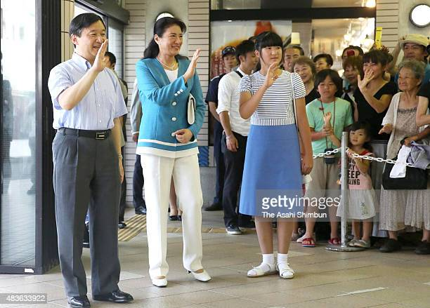 Crown Prince Naruhito Crown Princess Masako and Princess Aiko wave to wellwishers upon arrival at Izukyu Shimoda Station on August 11 2015 in Shimoda...