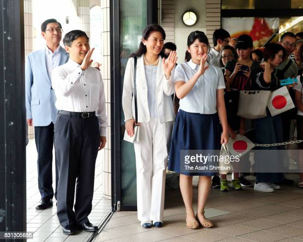 Crown Prince Naruhito Crown Princess Masako and Princess Aiko wave to wellwishers on arrival at Izukyu Shimoda Station on August 10 2017 in Shimoda...
