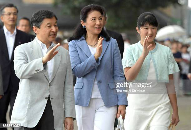 Crown Prince Naruhito Crown Princess Masako and their daughter Aiko wave to wellwishers on arrival at JR Nasushiobara Station on the way to the Nasu...