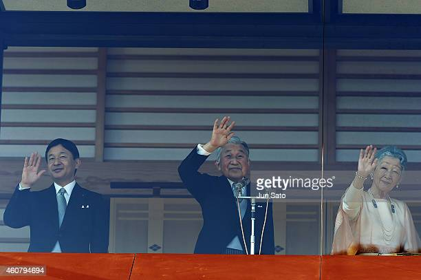 Crown Prince Naruhito Emperor Akihito and Empress Michiko Of Japan greet the public at the Imperial Palace on December 23 2014 in Tokyo Japan Emperor...