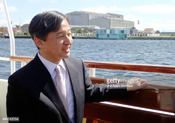 Crown Prince Naruhito is seen on a boat while cruising around Copenhagen Harbour on June 20 2017 in Copenhagen Denmark