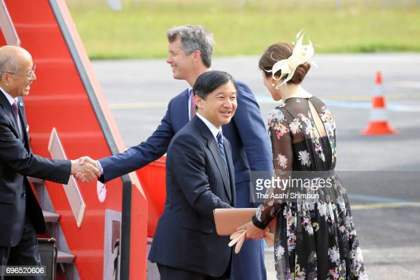 Crown Prince Naruhito is welcomed by Crown Prince Frederik and Crown Princess Mary of Denmark on arrival at Copenhagen Airport on June 15 2017 in...