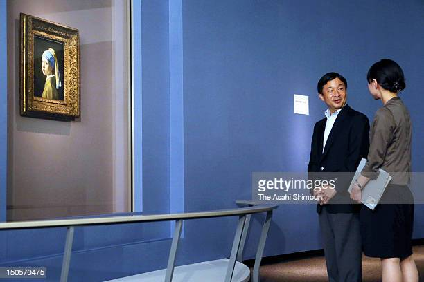 Crown Prince Naruhito listens to explanations in front of Johannes Vermeer's 'Girl with a Pearl Earring' drawn from the collection of Mauritshuis at...