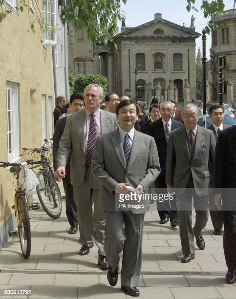 Crown Prince Naruhito of Japan centre surrounded by aides and security men while in Oxford The Crown Prince is on an official visit to Britain and...