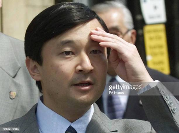 Crown Prince Naruhito of Japan is shields his eyes from the suns glare during his walkabout in Oxford The Crown Prince is on an official visit to...