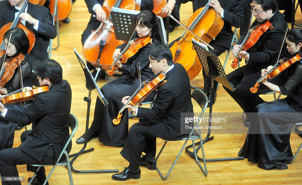 <a gi-track='captionPersonalityLinkClicked' href=/galleries/search?phrase=Crown+Prince+Naruhito&family=editorial&specificpeople=158365 ng-click='$event.stopPropagation()'>Crown Prince Naruhito</a> of Japan plays viola at 66th concert held at his alma mater Gakushuin University in centenary celebration on December 16, 2012 in Tokyo, Japan.
