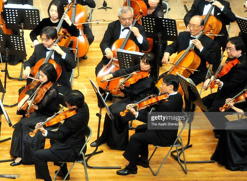 Crown Prince Naruhito of Japan plays viola at 66th concert held at his alma mater Gakushuin University in centenary celebration on December 16, 2012 in Tokyo, Japan.