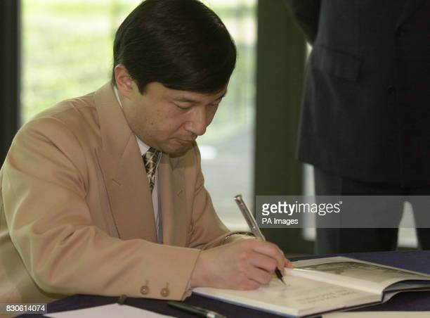 Crown Prince Naruhito of Japan signs a copy of his thesis on the navigation on the River Thames in the 18th century during his visit to the National...