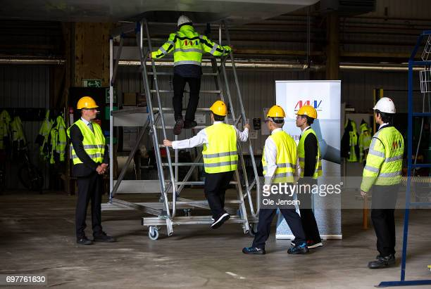 Crown Prince Naruhito of Japan visits MHI Vestas Offshore Wind where he is shown the large nacelle generator on June 19 Odense Denmark The windmill...