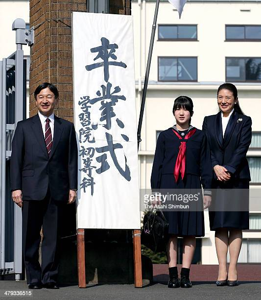 Crown Prince Naruhito Princess Aiko and Crown Princess Masako pose for photographs as they attend Princess Aiko's graduation ceremony at Gakushuin...