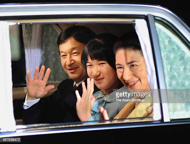 Crown Prince Naruhito Princess Aiko and Crown Princess Masako wave on arrival at the Imperial Palace to celebrate Empress Michiko's 80th birthday on...