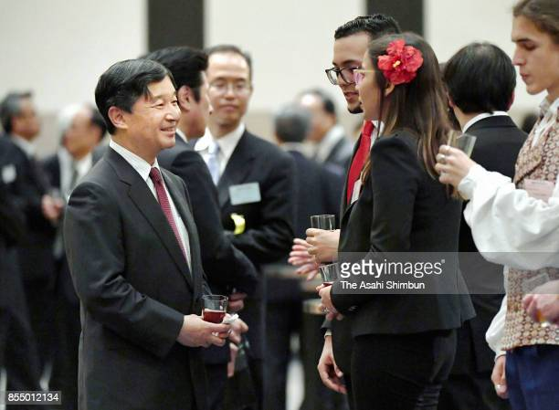 Crown Prince Naruhito talks to participants during the reception of the International Youth Conference on September 27 2017 in Tokyo Japan