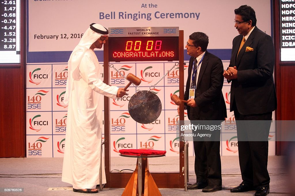 Crown Prince of Abu Dhabi and Deputy Supreme Commander of the UAE Armed Forces Sheikh Mohammed Bin Zayed Al Nahyan (L) and Bombay Stock Exchange (BSE) managing director and chief executive officer Ashish Kumar Chauhan (C) attend a bell ringing ceremony at the Bombay Stock Exchange (BSE) in Mumbai, India on February 12, 2016. Crown Prince Nahyan is accompanied by a high-level delegation scheduled to meet top Indian politicians to strengthen political and business ties between the two counties, media reported.