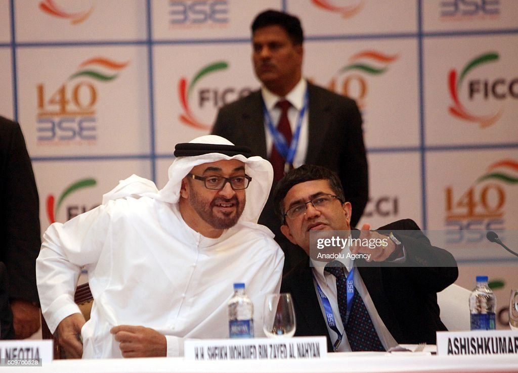 Crown Prince of Abu Dhabi and Deputy Supreme Commander of the UAE Armed Forces Sheikh Mohammed Bin Zayed Al Nahyan (L) and Bombay Stock Exchange (BSE) managing director and chief executive officer Ashish Kumar Chauhan (R) attend a bell ringing ceremony at the Bombay Stock Exchange (BSE) in Mumbai, India on February 12, 2016. Crown Prince Nahyan is accompanied by a high-level delegation scheduled to meet top Indian politicians to strengthen political and business ties between the two counties, media reported.