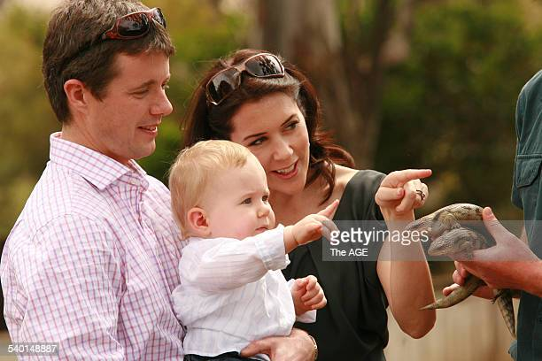 Crown Prince of Denmark Prince Frederik with his wife Crown Princess Mary and their son Christian inspect a pair of blue tongue lizards at the...