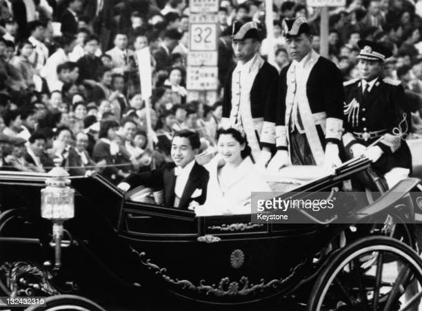 Crown Prince of Japan Akihito and Michiko Shoda driving through Tokyo after their wedding at Tokyo Imperial Palace 10th April 1959