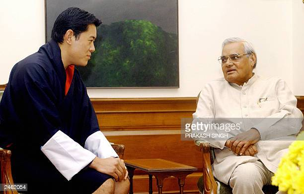 Crown Prince of the Kingdom of Bhutan Dasho Jigme Khesar Namgyel Wangchuck listens to Indian Prime Minister Atal Behari Vajpayee during a meeting at...