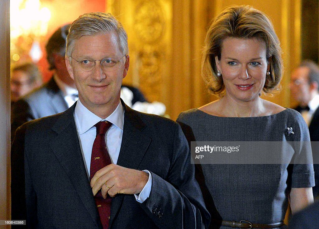 Crown Prince Philippe of Belgium and Princess Mathilde of Belgium (R) walk during a dinner at the Diplomatic Contact Days 2013, at the Egmont Palace in Brussels, on February 4, 2013. Belgium Out