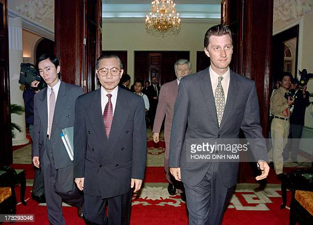 Crown Prince Philippe of Belgium and Vietnamese Foreign minister Nguyen Manh Cam arrive for a welcoming ceremony at the Government Guest House on...